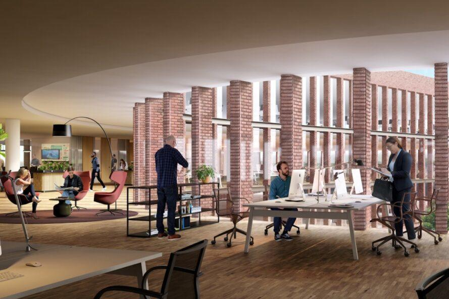 rendering of people working at computers in office with exposed brick walls