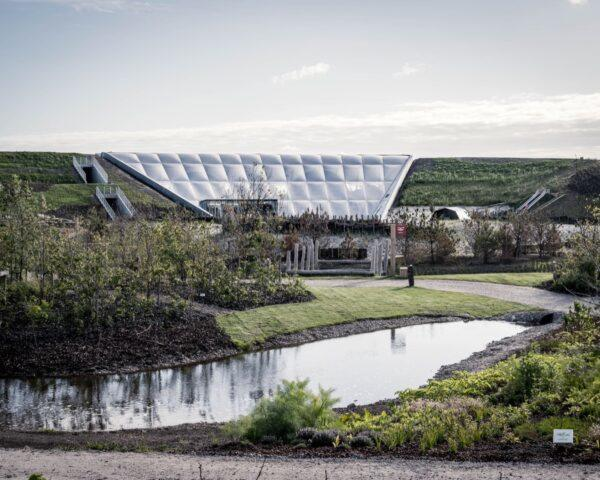 small pond in front of a white structure made from ETFE