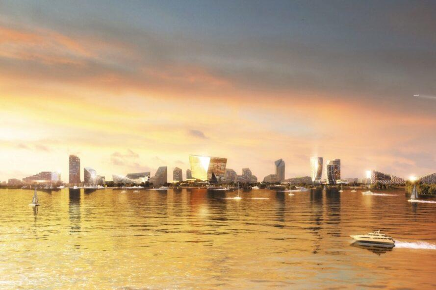rendering of waterfront glass towers in a city at sunset