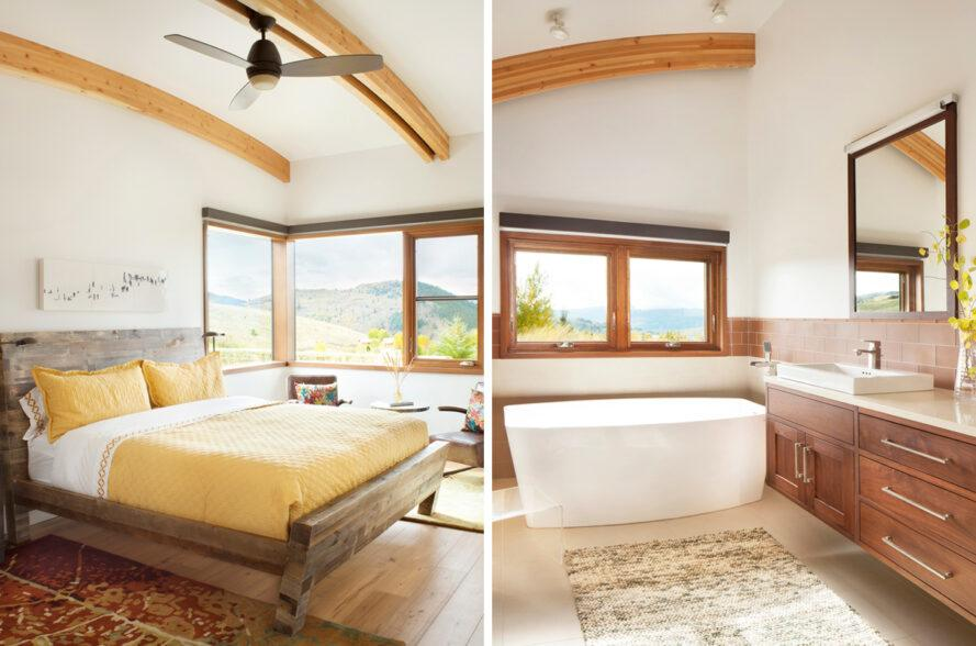 On the left, large bed with yellow bedding. On the right, bathroom with freestanding tub.