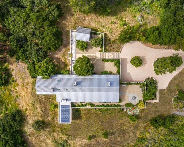 aerial view of long gabled home with solar panels