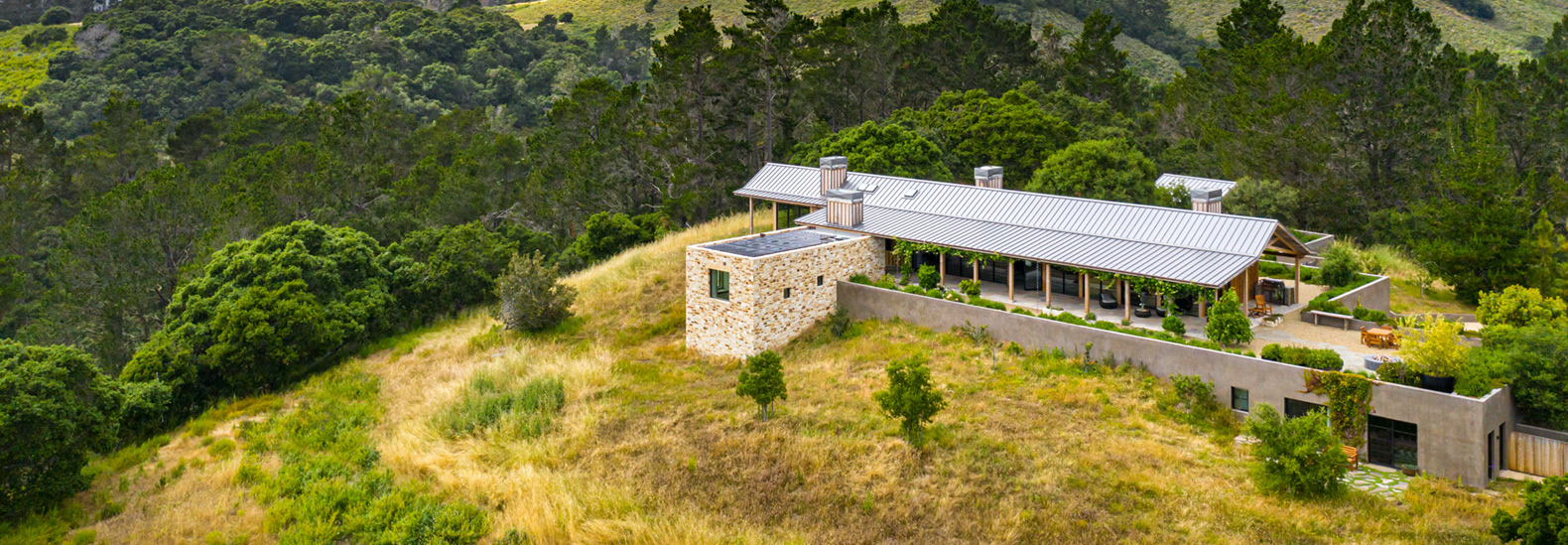 This net-zero home is integrated into the slopes of Carmel Valley