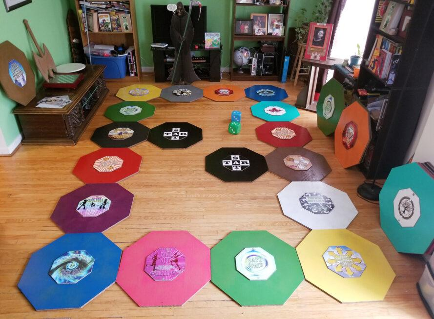living room floor covered in colorful DIY boardgame tiles