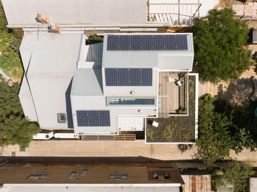 aerial view of rows of solar panels on gabled roofs