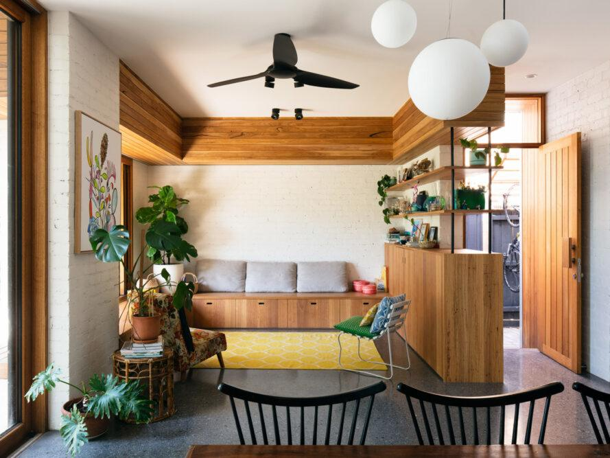 living space with wood bench, wood shelves and lots of plants