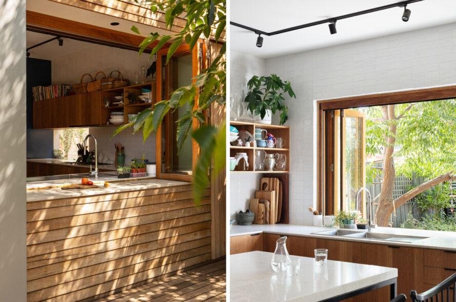 kitchen with large window over the sink opening up to the backyard