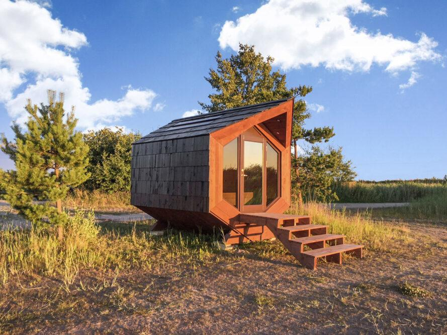 angular tiny wood cabin on wooded lot
