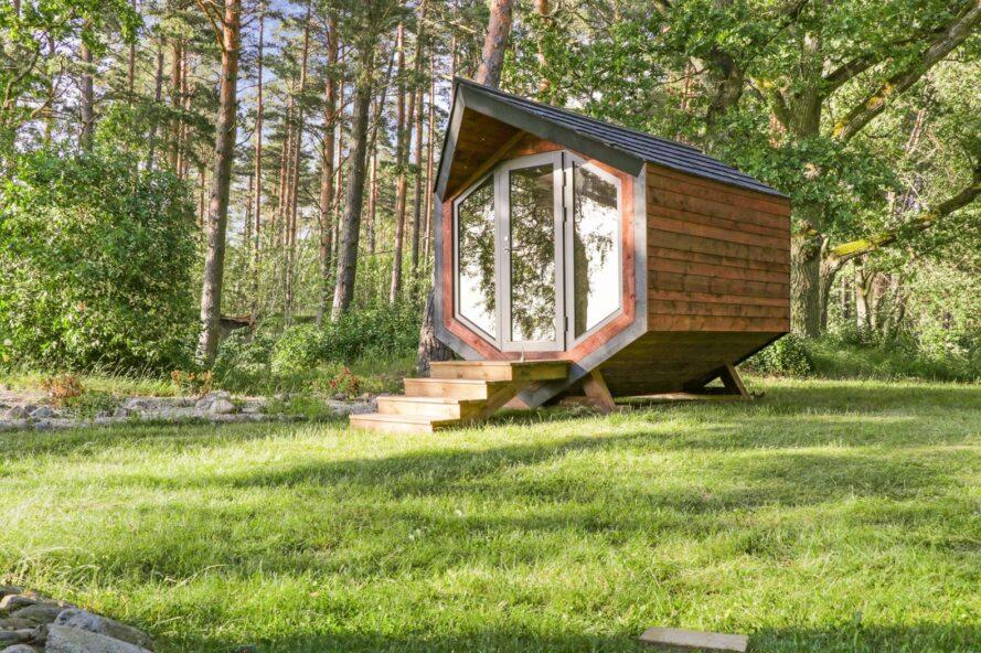angular wood cabin surrounded by trees