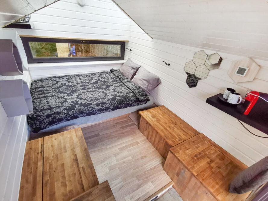 tiny cabin interior with full-sized bed