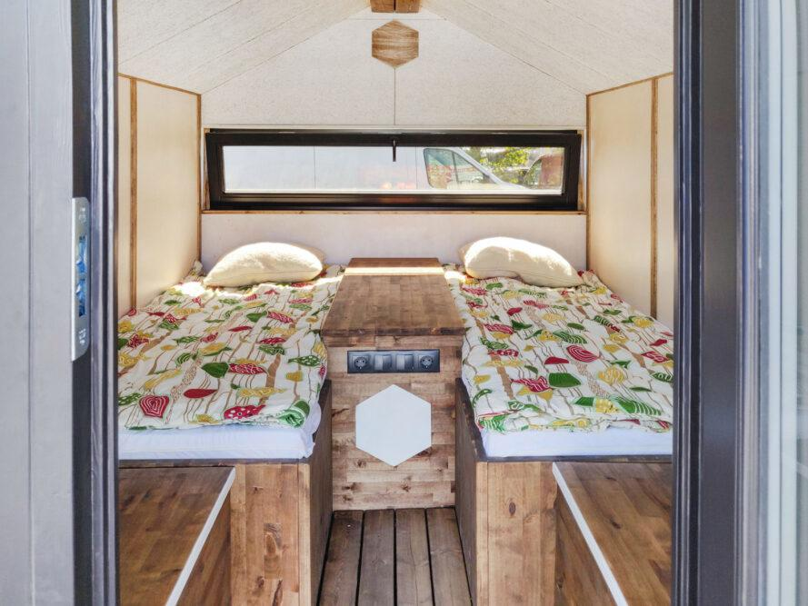 tiny cabin interior with two twin beds