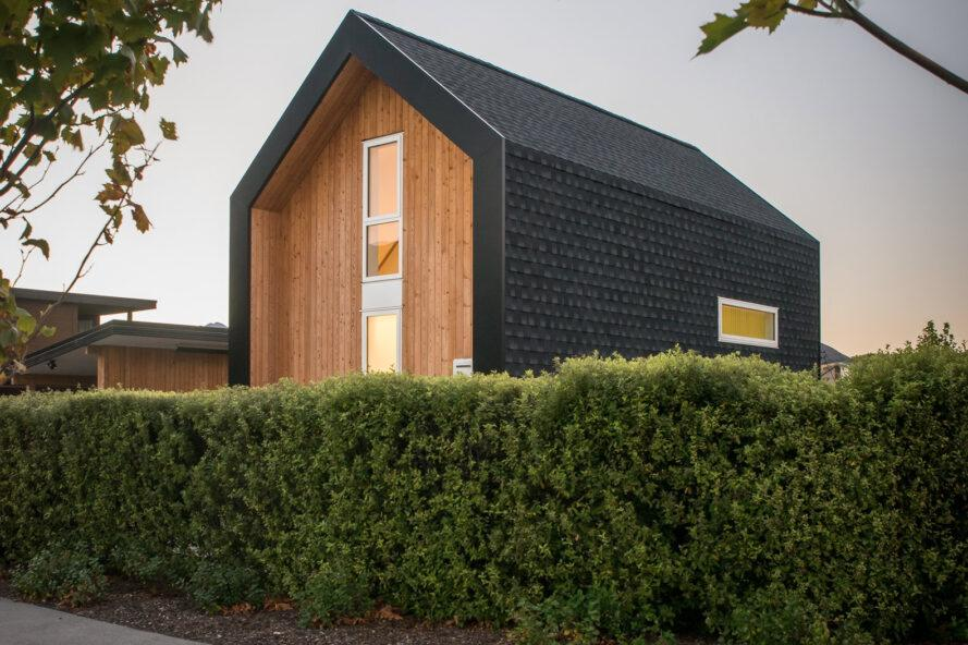 light and dark wood tiny home with gabled roof