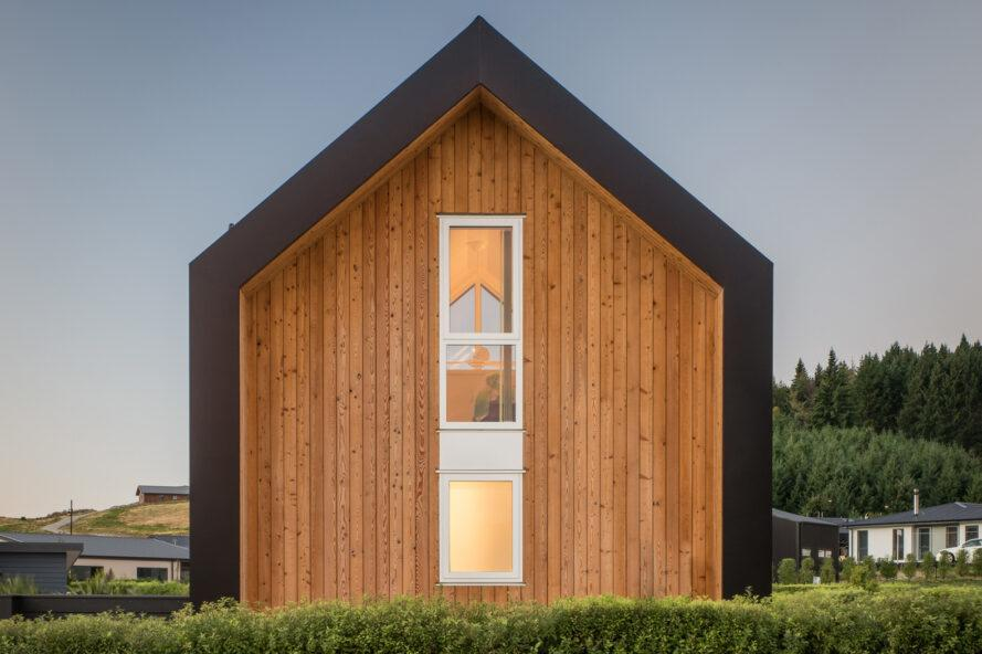 gabled tiny home with double-height, narrow window