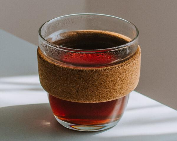 glass coffee cup with cork exterior