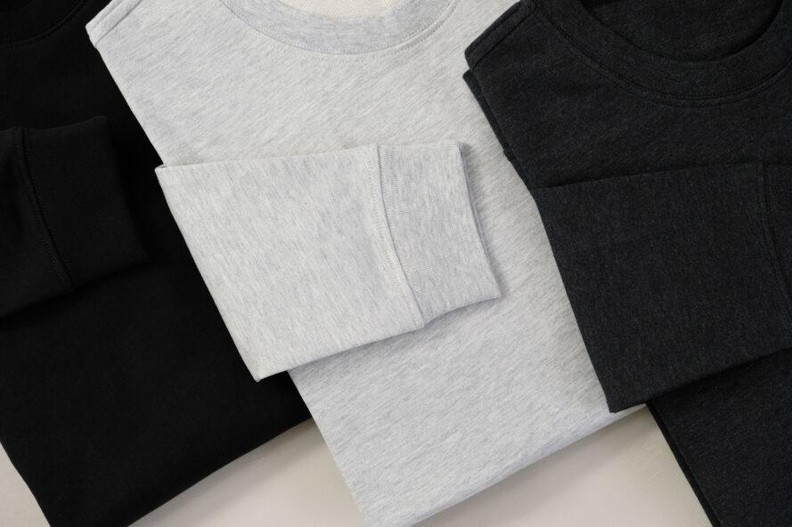 three folded pullover sweaters