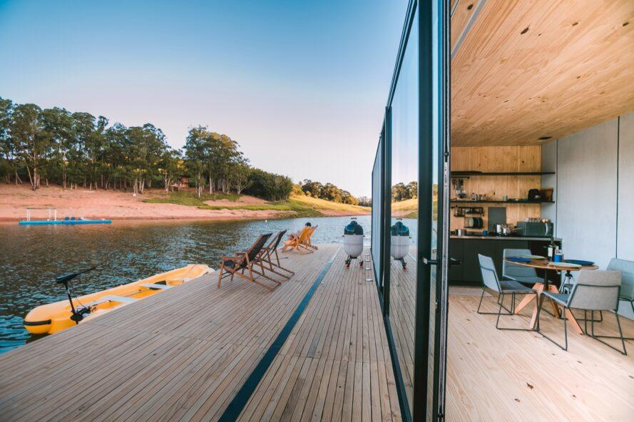 open sliding glass door connected to a deck of a floating home