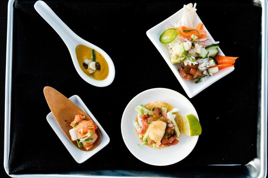 BlueNalu's whole-muscle, cell-based yellowtail prepared in four different recipes (clockwise from top left)/ roasted butternut squash & yellowtail bisque, poke bowl, fish taco, and kimchi