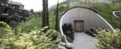 rounded building with a hilly green roof