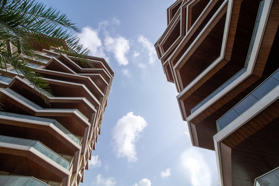 worm's eye view of two towers with staggered balconies