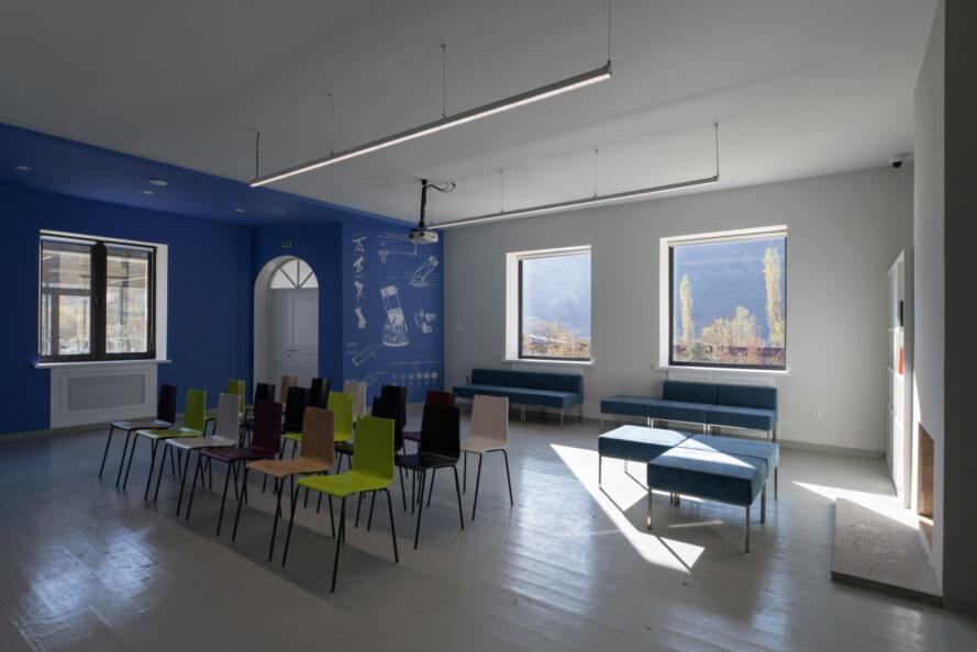 white and blue classroom with square windows