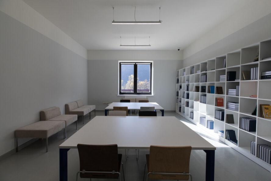 white classroom with wall of bookshelves
