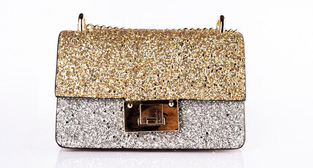 glitter gold and silver purse on white background