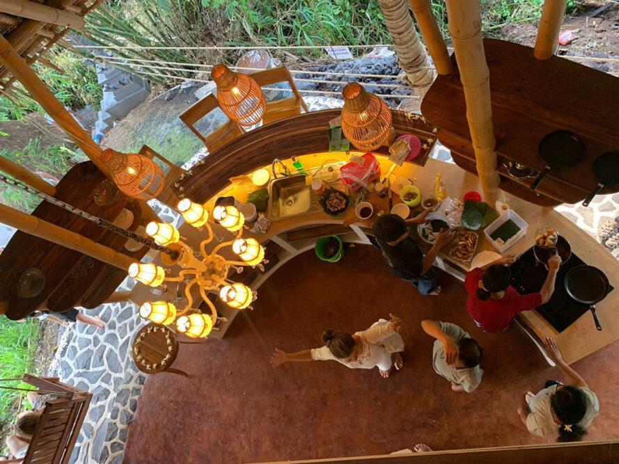 aerial view of people preparing food in covered outdoor kitchen