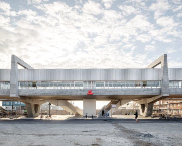 elongated, elevated metro station made of concrete