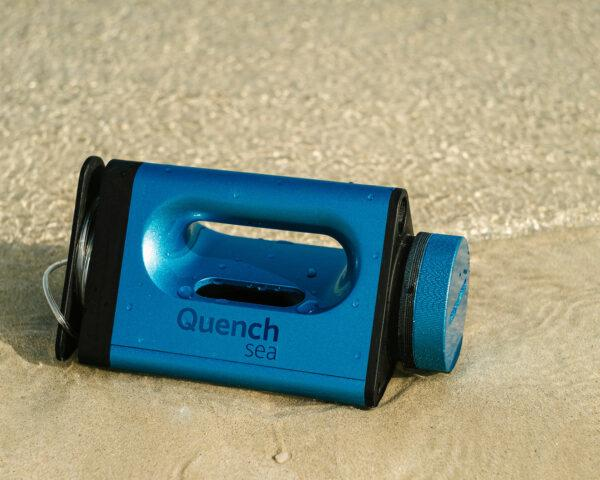 small blue desalination device on a beach
