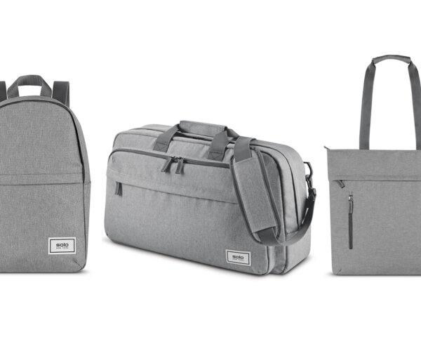 gray backpack, gray luggage bag and gray tote on white background