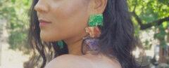 close-up of multicolored stone earrings