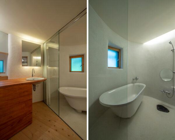 white bathroom with free-standing tub and small square window