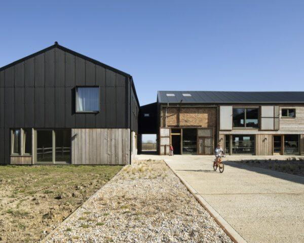 black and light wood barn with gabled roof