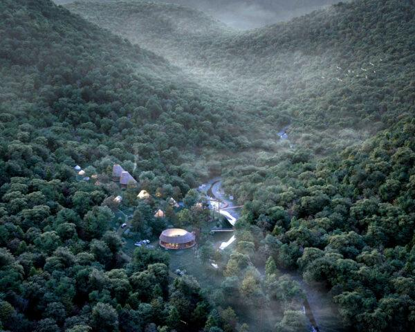 aerial rendering of wood buildings in a misty forest