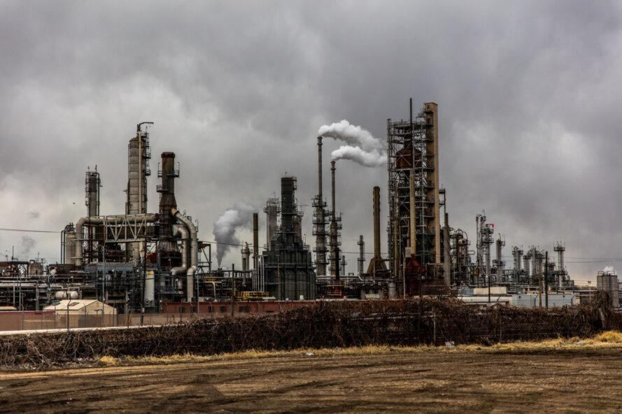 fossil fuel plant against cloudy skies