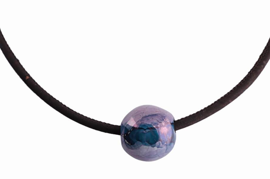 a black cord with a circular purple bead.