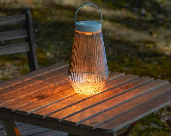 solar-powered lantern on a wood table