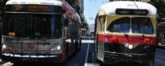 bus and tram driving side-by-side on San Francisco street