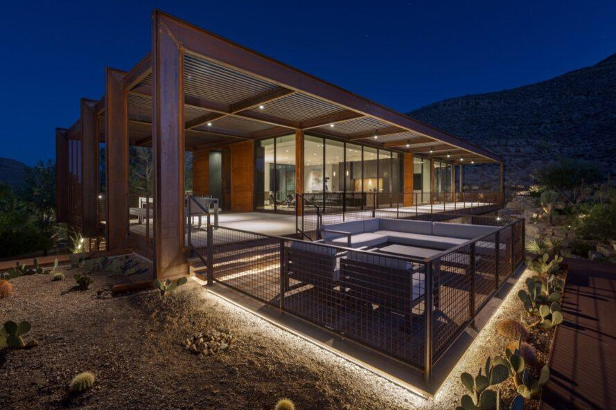 covered patio of desert home at night