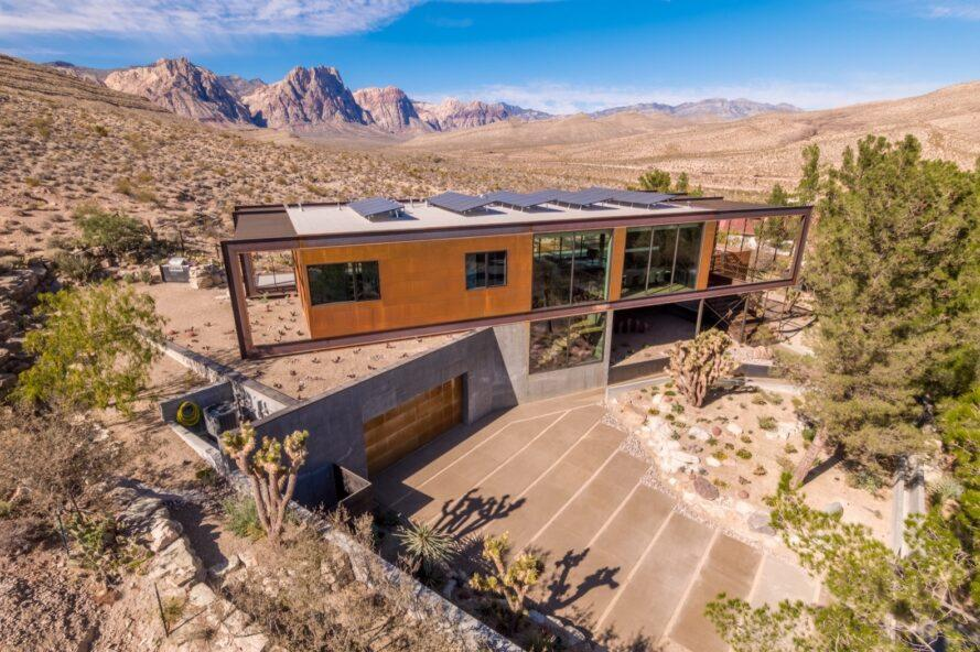aerial view of weathered steel home topped with solar panels