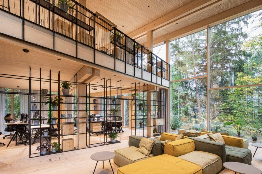 light timber office interior with modern furniture and glass walls