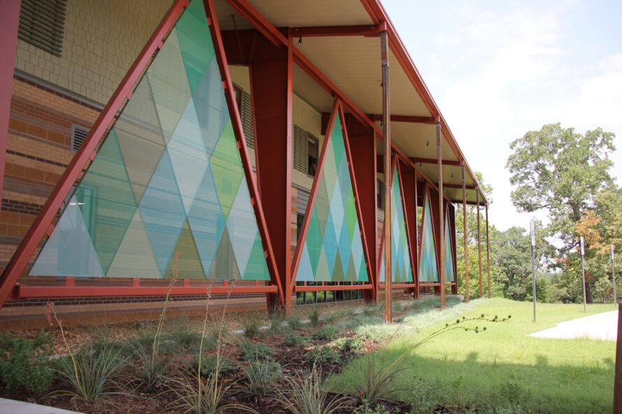 close-up of colorful triangle details on Camp Trivera building exterior