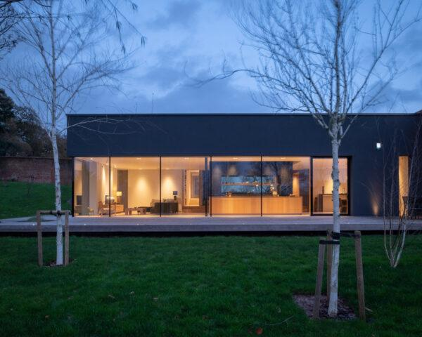 dark gray home with wall of glass