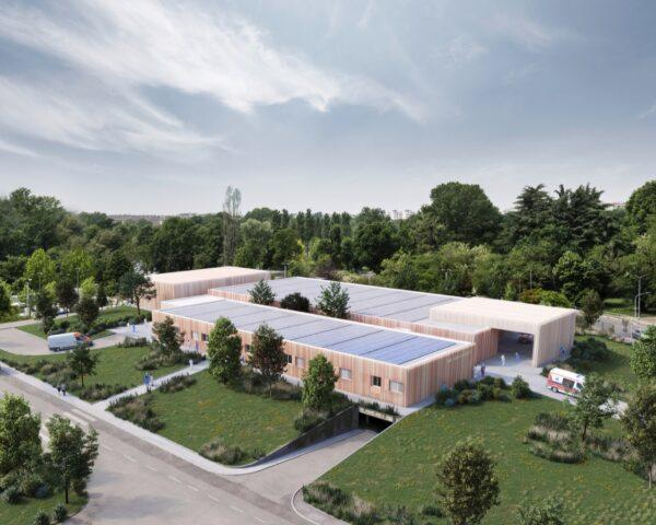 large hospital building topped with solar panels