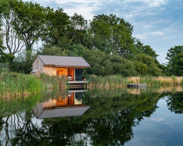 small wood cabin by a lake