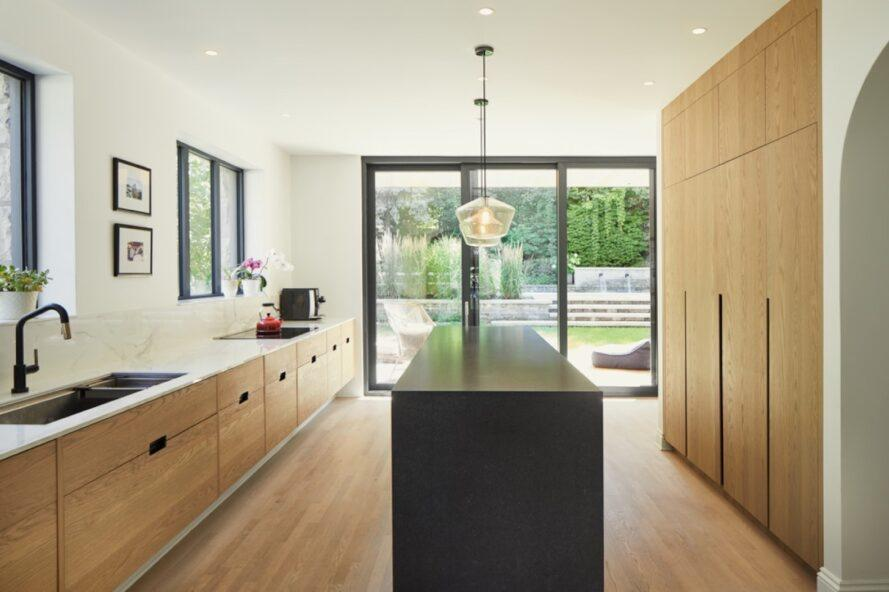 kitchen with light wood cabinets and a black island