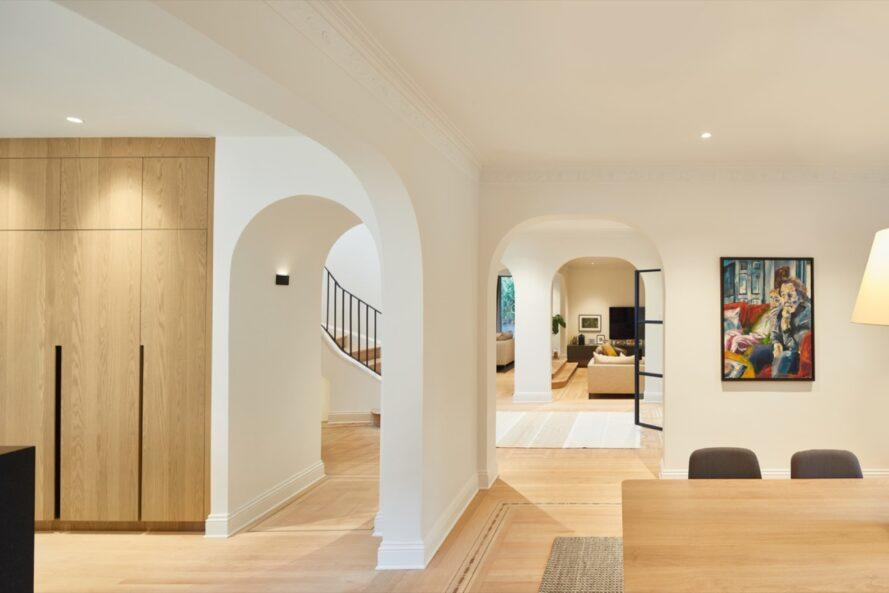 white home interior with curved doorways