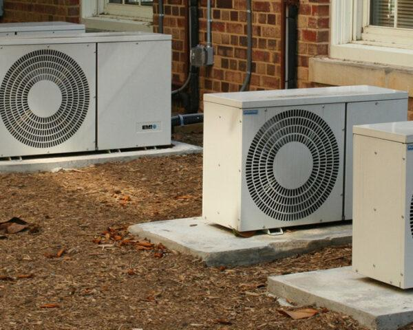 air conditioners against side of brick building