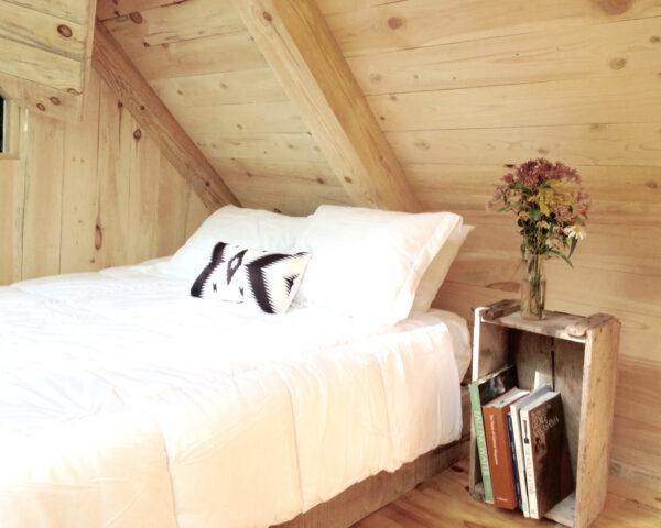 white bed in wood room