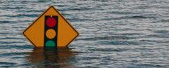 flood waters around a traffic sign