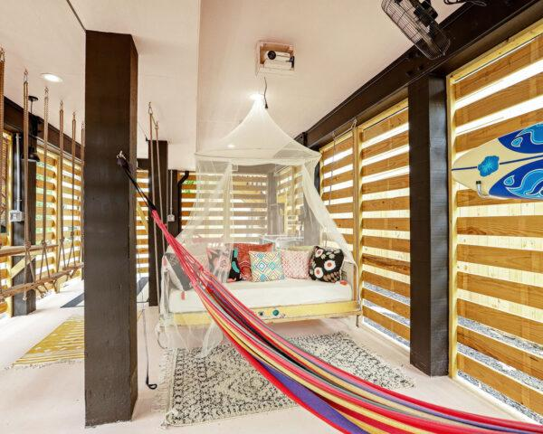 covered patio with hammock and hanging bed